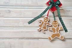 Sweet homemade cookies with gift for Christmas on white old wood Stock Photo