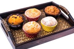 Sweet homemade cupcakes on wooden tray, white background royalty free stock images