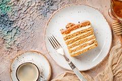 Sweet homemade honey cake. Sweet homemade layered honey cake on a light background, top view Royalty Free Stock Image