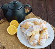 Sweet homemade lemon croissants with powdered sugar. Stock Photography