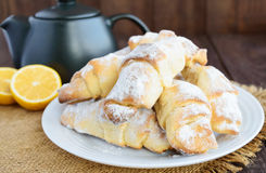 Sweet homemade lemon croissants with powdered sugar. Stock Images