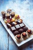 Sweet homemade mini cakes on the table Royalty Free Stock Photo