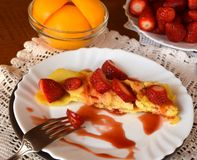 Sweet homemade pancakes decorated with strawberries on a white plate. Stock Photography