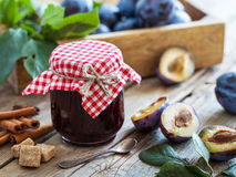 Sweet homemade plum jam and fruits on table. Royalty Free Stock Image