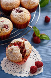 Sweet homemade raspberry muffins on wooden table. Royalty Free Stock Image