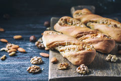 Sweet homemade rolls stuffed with walnut. Royalty Free Stock Photos