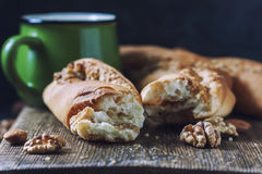 Sweet homemade rolls stuffed with walnut. Royalty Free Stock Photography