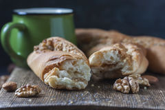 Sweet homemade rolls stuffed with walnut. Royalty Free Stock Image