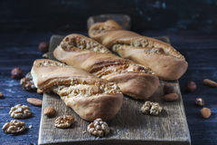Sweet homemade rolls stuffed with walnut. Stock Image