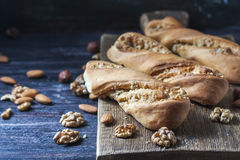Sweet homemade rolls stuffed with walnut. Stock Photos