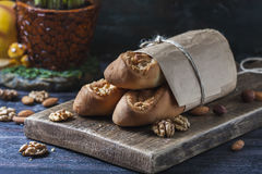 Sweet homemade rolls stuffed with walnut. Stock Images