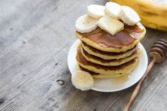 Sweet Homemade Stack of Pancakes with Butter, banan and Honey for Breakfast. / royalty free stock images