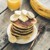 Sweet Homemade Stack of Pancakes with Butter, banan and Honey for Breakfast. / royalty free stock photography