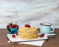 Sweet Homemade Stack of Pancakes with cherries royalty free stock photo