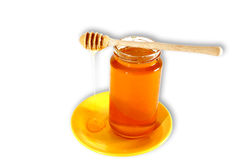 Sweet honey. Jar with honey on a plate Stock Photography