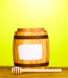 Sweet honey in barrel with drizzler Royalty Free Stock Photos