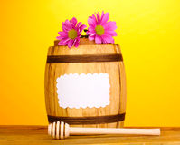 Sweet honey in barrel with drizzler Stock Photos