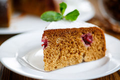 Sweet honey cake with cherries Royalty Free Stock Images