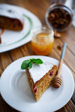 Sweet honey cake with cherries Stock Photography