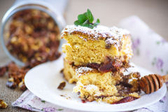 Sweet honey cake with nuts Royalty Free Stock Photo