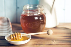 Sweet honey on dipper Stock Photography