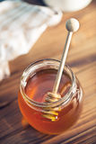 Sweet honey on dipper Royalty Free Stock Image
