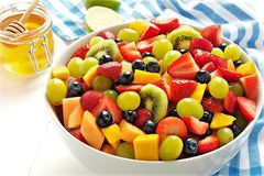 Sweet honey fruity salad stock photo