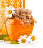 Sweet honey in glass jars with flowers Royalty Free Stock Images