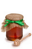 Sweet honey in jar with drizzler Royalty Free Stock Photo