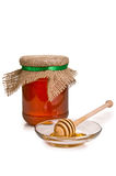 Sweet honey in jar with drizzler Royalty Free Stock Image