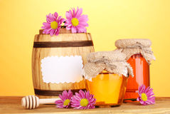 Sweet honey in jars and barrel Stock Images