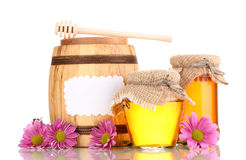 Sweet honey in jars and barrel with drizzler Royalty Free Stock Image