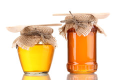 Sweet honey in jars with spoons Royalty Free Stock Photography