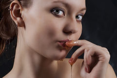 Sweet honey on lips Stock Images