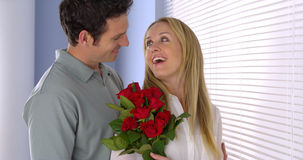 Sweet husband surprises his wife with flowers Royalty Free Stock Photos