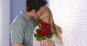 Sweet husband surprises his wife with flowers Stock Photo