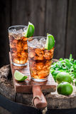 Sweet iced tea with ice cubes and mint Stock Photo