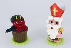 Sweet incubus and  saint Nicholas Royalty Free Stock Image
