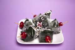 Sweet Indian Pan in white plate and purple background stock photos