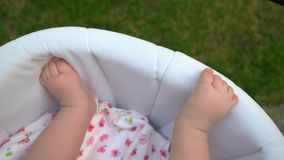 Sweet infant baby legs. stock footage