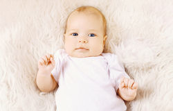 Sweet infant lying on the bed Royalty Free Stock Photos