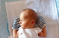 Sweet infant sleeping on the bed at home royalty free stock image