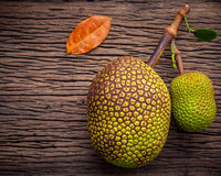 Sweet Jack fruit on shabby wooden background .Tropical fruit  sw. Eet and aromatic flesh of a ripe jack fruit ('Artocarpus heterophyllus') tempts buyers at a Royalty Free Stock Image