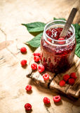 Sweet jam with raspberries. Royalty Free Stock Images