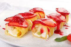 Sweet japanese roll. With strawberries and strawberry jam Royalty Free Stock Photos