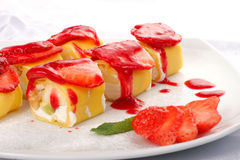 Sweet japanese roll. With strawberries closeup Stock Photos