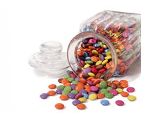 Sweet jar with sweets spilling out Royalty Free Stock Image