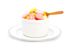 Sweet jelly in cup and wood spool on white background Stock Photos
