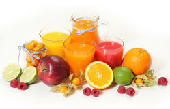Sweet juice and fruits Stock Photos