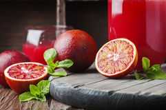 Sweet juice with red oranges and mint Royalty Free Stock Photo